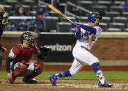 New York Mets' Francisco Lindor follows through on a double against the Arizona Diamondbacks during the fifth inning of a baseball game Saturday, May 8, 2021, in New York. (AP Photo/Noah K. Murray)