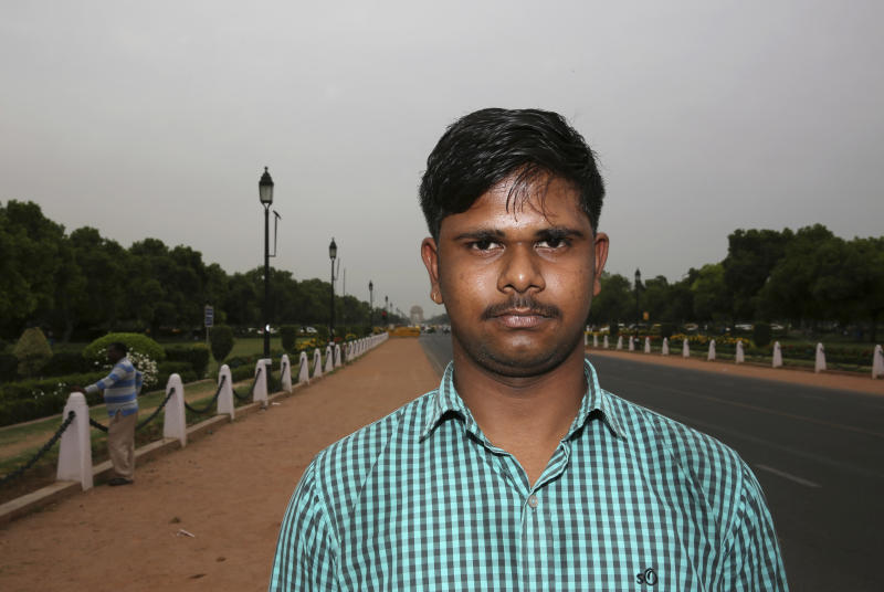 "In this Tuesday, April 16, 2019, photo, engineering student Mayank Thakur, 18, stands for a photograph in New Delhi, India. With nearly half the electorate under 35 and more than 15 million first time voters, India's young can swing the national vote in the world's largest democracy in any direction. ""Unemployment is very high in India currently. India has a lot of engineers who haven't been able to develop their skills because there aren't enough jobs for them in India,"" Mayank told the Associated Press. (AP Photo/Manish Swarup)"