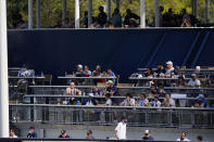 Fans watch during the fourth inning of a spring baseball game between the New York Yankees and the Toronto Blue Jays Sunday, Feb. 28, 2021, in Tampa, Fla. (AP Photo/Frank Franklin II)