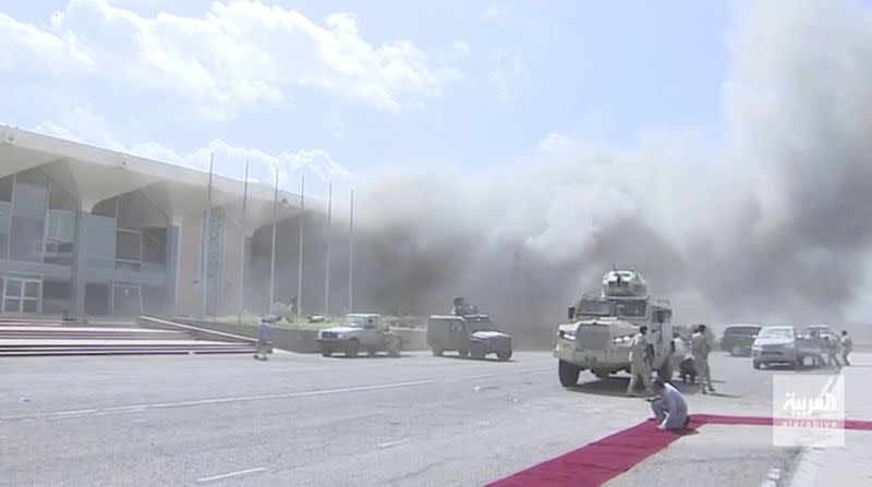 Dust rises after explosions hit Aden airport, upon the arrival of the newly-formed Yemeni government in Aden