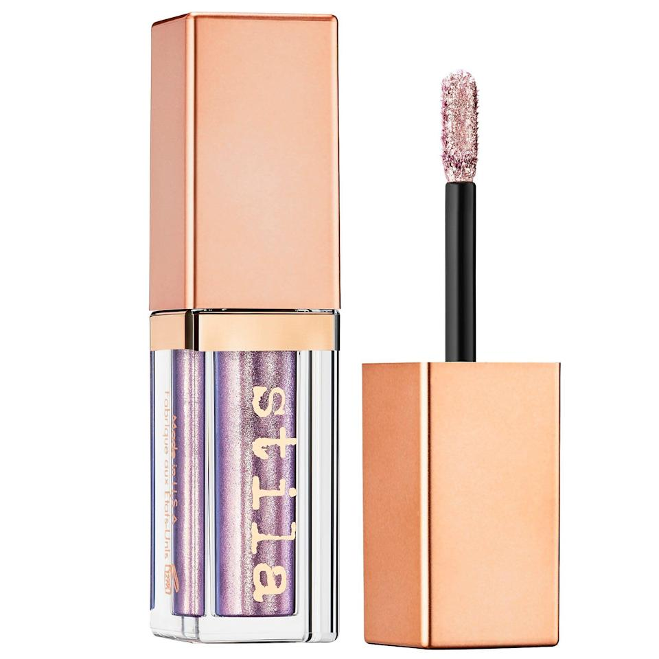 """<p><a href=""""https://www.allure.com/story/stila-shimmer-and-glow-liquid-eye-shadow-preview?mbid=synd_yahoo_rss"""" rel=""""nofollow noopener"""" target=""""_blank"""" data-ylk=""""slk:Stila's Shimmer & Glow Liquid Eye Shadow"""" class=""""link rapid-noclick-resp"""">Stila's Shimmer & Glow Liquid Eye Shadow</a> is pure dreaminess in a tube. Beloved by beauty editors, bloggers, and professionals alike, they make a solid staple in one's makeup collection. Makeup artist and Beauty Is Boring founder <a href=""""https://www.instagram.com/robinblackmma/"""" rel=""""nofollow noopener"""" target=""""_blank"""" data-ylk=""""slk:Robin Black"""" class=""""link rapid-noclick-resp"""">Robin Black</a> says they're one of her must-haves for several reasons. """"They're easy to use, long-lasting, provide a ton of color payoff, and come in a fun range of colors,"""" she says.</p> <p><strong>$24</strong> (<a href=""""https://shop-links.co/1718208441168929734"""" rel=""""nofollow noopener"""" target=""""_blank"""" data-ylk=""""slk:Shop Now"""" class=""""link rapid-noclick-resp"""">Shop Now</a>)</p>"""