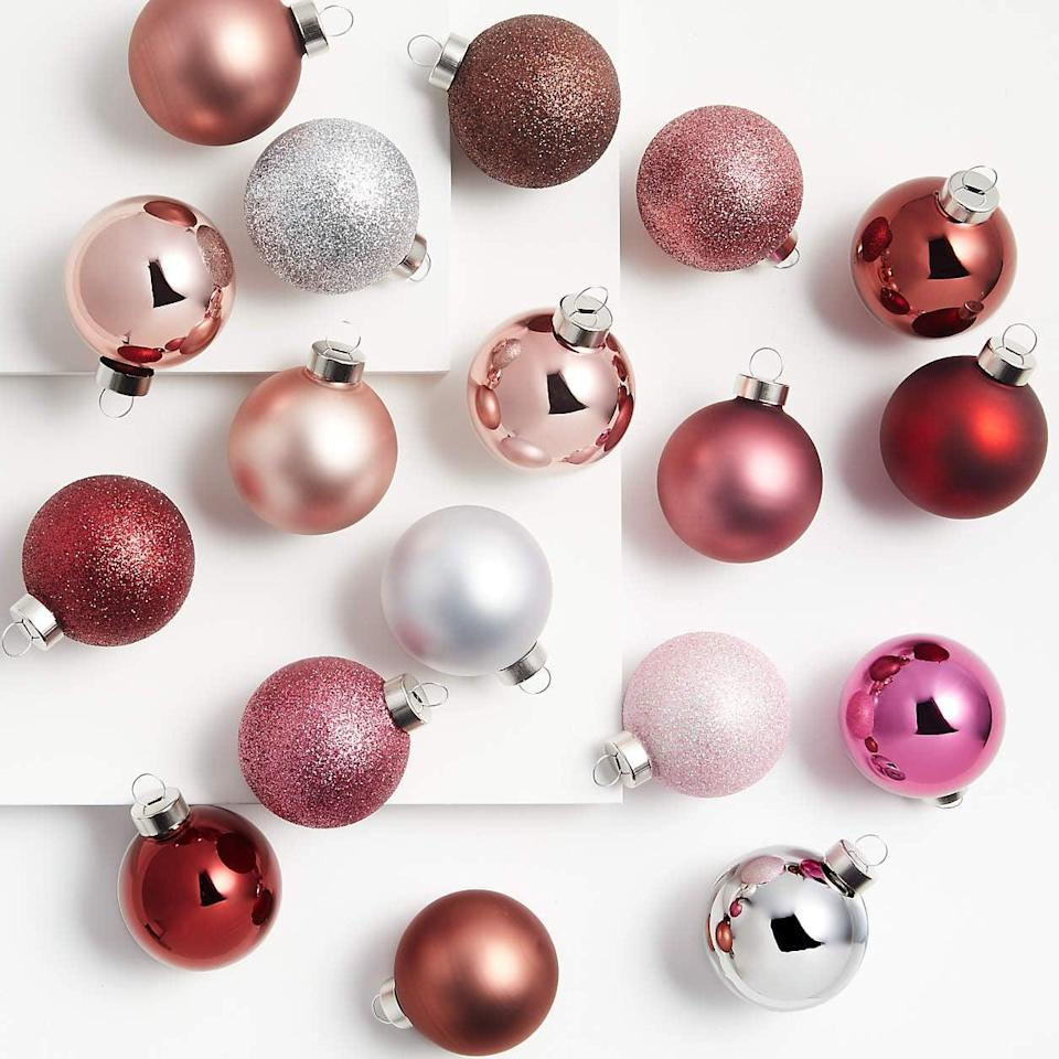 <p>This <span>Medium Blush Tonal Ball Ornaments, Set of 18</span> ($30) will help you add some depth to your tree. </p>