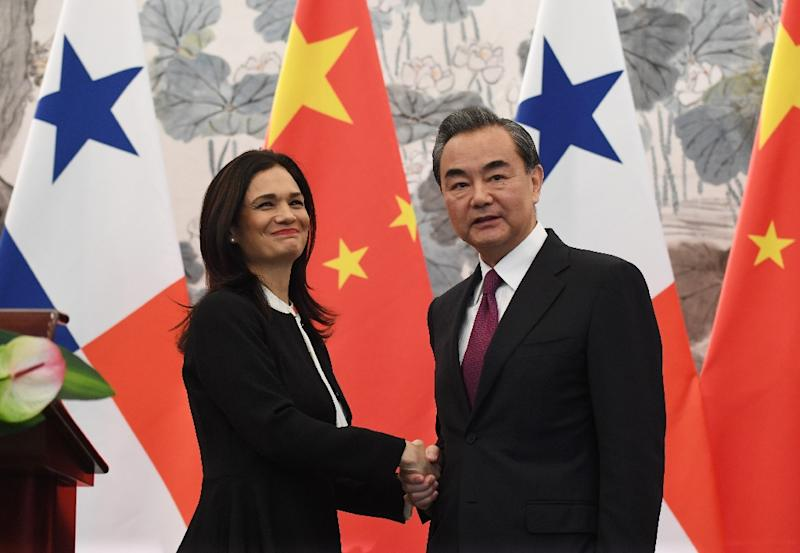 Panama's Vice President and Foreign Minister Isabel Saint Malo shakes hands with Chinese Foreign Minister Wang Yi after the two signed a joint communique agreeing to establish diplomatic relations, in Beijing, on June 13, 2017