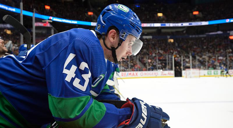 Canucks' Quinn Hughes left Friday night's game against the Anaheim Ducks after twisting his ankle in the first period. (Photo by Derek Cain/NHLI via Getty Images)