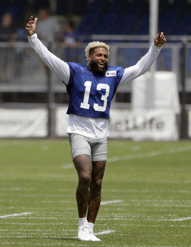 FILE - In this Aug. 7, 2018, file photo, New York Giants' Odell Beckham Jr. gestures after a practice at the NFL football team's training camp in East Rutherford, N.J. Beckham Jr. is now the NFLs highest-paid wide receiver. A person familiar with the negotiations told The Associated Press Monday, Aug. 27, 2018, the team agreed to a five-year contract extension with the three-time Pro Bowler. The person spoke on condition of anonymity because the Giants have not announced the deal, which comes less than two weeks before the season opener against Jacksonville. (AP Photo/Seth Wenig, File)