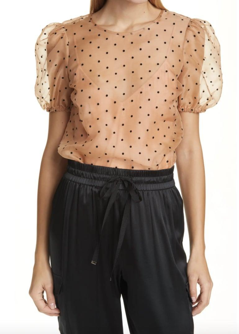 <p>The pretty fabric of this <span>CAMI NYC Bethany Puff Sleeve Mesh Dot Bodysuit</span> ($258) sold us. </p>