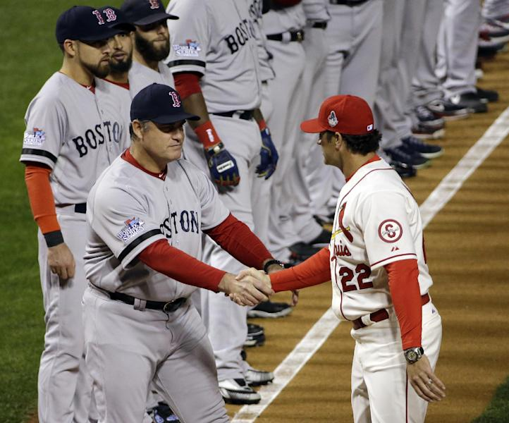 Boston Red Sox manager John Farrell shakes hands with St. Louis Cardinals manager Mike Matheny before Game 3 of baseball's World Series Saturday, Oct. 26, 2013, in St. Louis. (AP Photo/David J. Phillip)