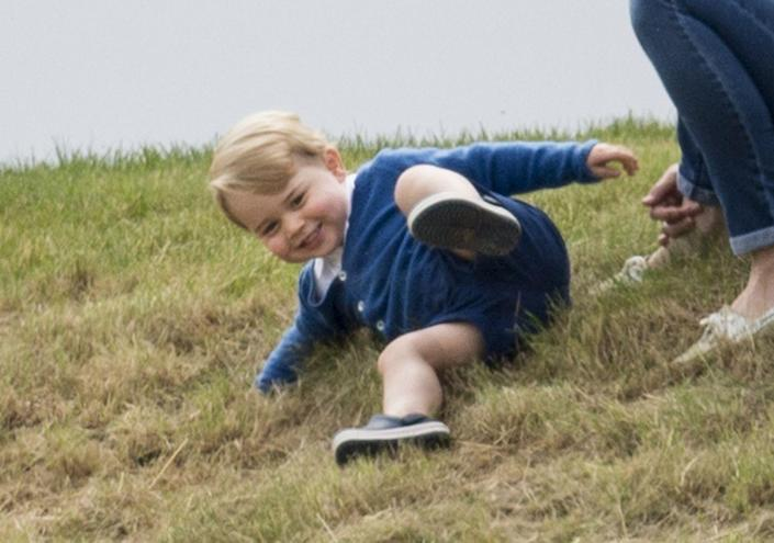 """<p>Rolling down the hill at the <a href=""""https://www.townandcountrymag.com/leisure/arts-and-culture/a3296/prince-george-kate-middleton-charity-polo-match/"""" rel=""""nofollow noopener"""" target=""""_blank"""" data-ylk=""""slk:Gigaset Charity Polo Match at Beaufort Polo Club"""" class=""""link rapid-noclick-resp"""">Gigaset Charity Polo Match at Beaufort Polo Club</a>.</p>"""