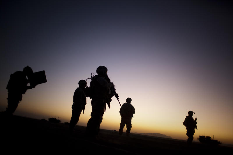 In this Sunday, Aug. 9, 2009 file photo, U.S. soldiers patrol the outskirts of Spin Boldak, near the border with Pakistan, about 100 kilometers (63 miles) southeast of Kandahar, Afghanistan. The U.S. Institute of Medicine recommended on Friday, July 13, 2012 that soldiers returning from Iraq and Afghanistan be screened for post-traumatic stress disorder at least once a year and that federal agencies conduct more research to determine how well the various treatments for PTSD are working. (AP Photo/Emilio Morenatti)