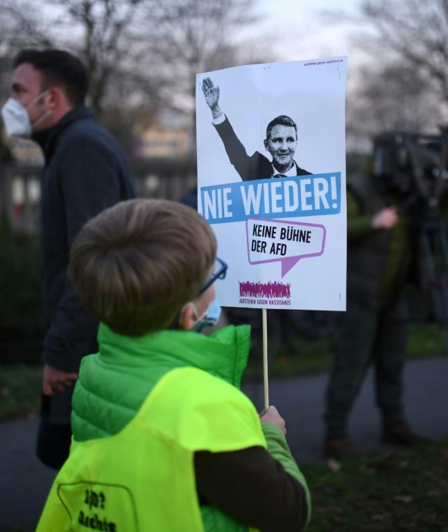 """A boy holds a placard urging no support for Bjoern Hoecke, leader of th AfD's far-right far-right """"Der Flügel"""" faction"""