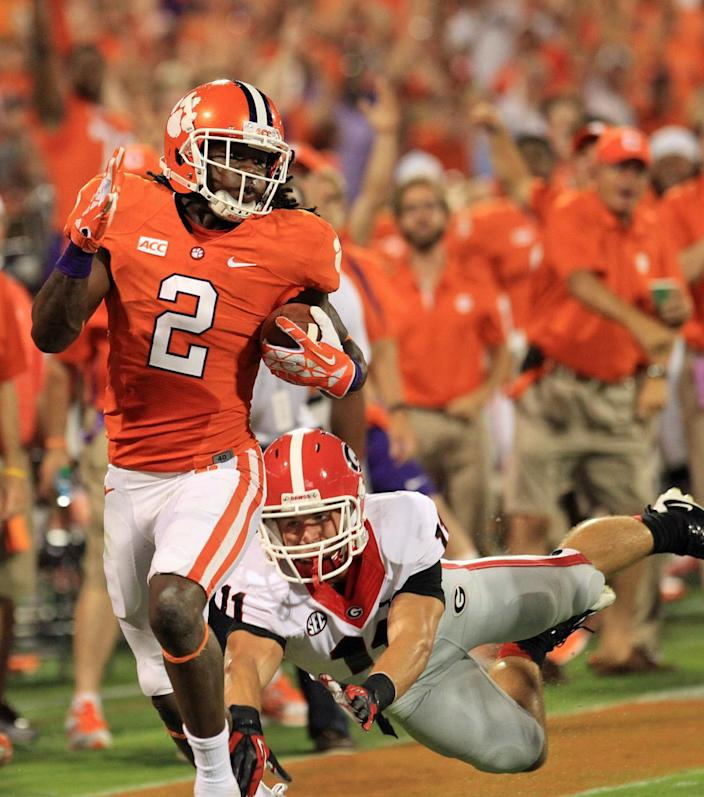 Clemson's Sammy Watkins, left, outruns Georgia safety Conor Norman as he scores on a 77-yard touchdown reception in the first quarter of their NCAA college football game Saturday, Aug. 31, 2013 in Clemson, S.C.(AP Photo/Anderson Independent-Mail, Mark Crammer)