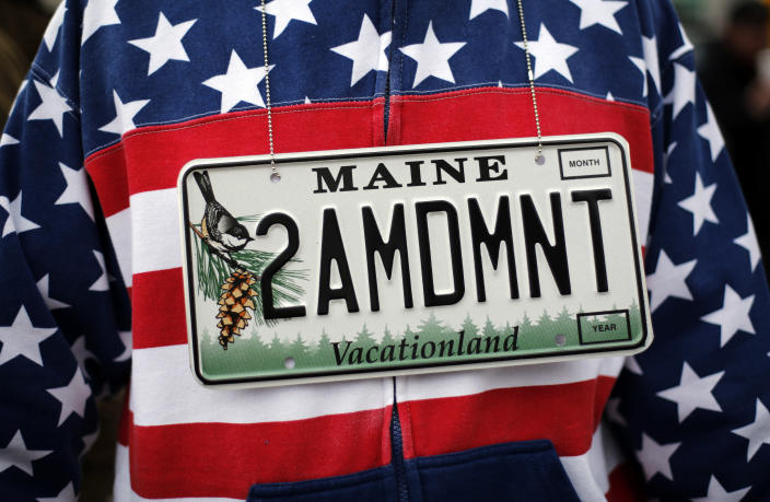 <p>Rocky Habeeb of Bangor, Maine wears a vanity license plate that will go on his new car while attending a gun rights rally, Saturday, April 14, 2018, at the State House in Augusta, Maine. (Photo: Robert F. Bukaty/AP) </p>