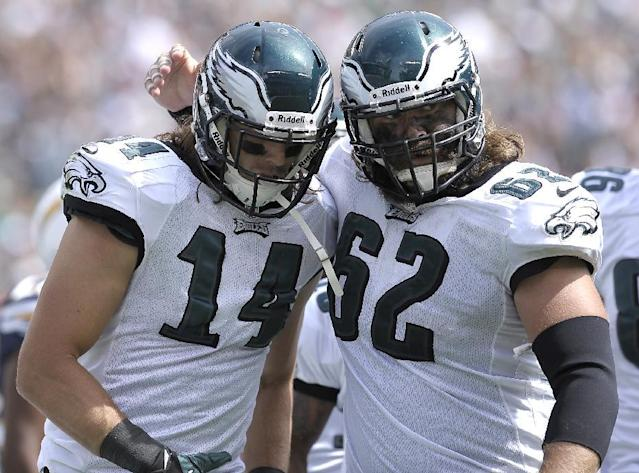 Philadelphia Eagles' Riley Cooper (14) and Jason Kelce is seen during an NFL football game against the San Diego Chargers, Sunday, Sept. 15, 2013, in Philadelphia. (AP Photo/Michael Perez)