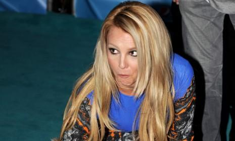 Perhaps getting in some practice for her future career as a novelist, Britney Spears writes her name at a hand-print ceremony in Los Angeles on Sept. 11.
