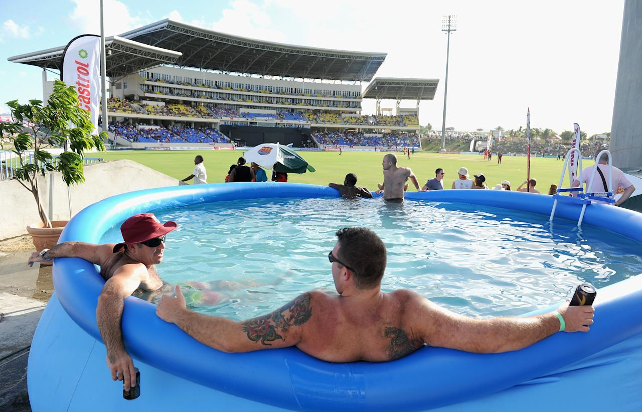ANTIGUA, ANTIGUA AND BARBUDA - FEBRUARY 28:  Cricket fans watch play from a swimming pool during the 1st One Day International between West Indies and England at Sir Viv Richards Cricket Ground on February 28, 2014 in Antigua, Antigua and Barbuda.  (Photo by Gareth Copley/Getty Images)
