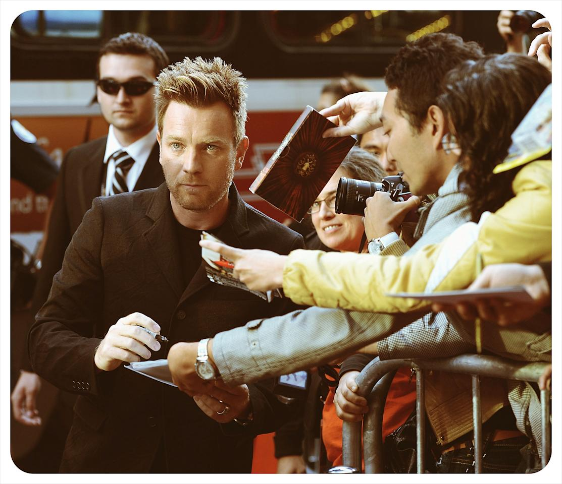 TORONTO, ON - SEPTEMBER 09:  <<(EDITORS NOTE: Image was processed using various digital filters) Actor Ewan McGregor signs autographs and hangs out with fans outside 'The Impossible' Premiere at the 2012 Toronto International Film Festival at the Princess of Wales Theatre on September 9, 2012 in Toronto, Canada.  (Photo by Jason Merritt/Getty Images)