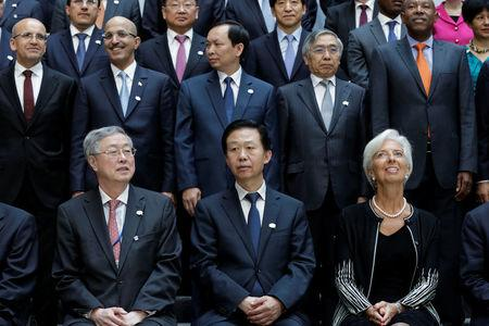 G-20 finance ministers and central bank governors pose for a family photo during the IMF/World Bank spring meetings in Washington, U.S., April 21, 2017. REUTERS/Yuri Gripas