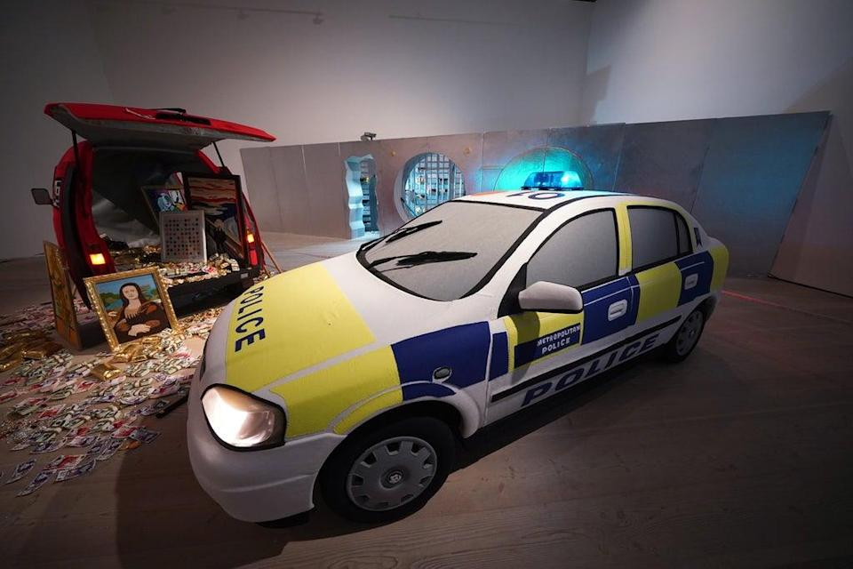 A Metropolitan Police squad car with blue lights flashing has arrived on the scene to intercept the perpetrators of a billion-dollar robbery (Yui Mok/PA) (PA Wire)