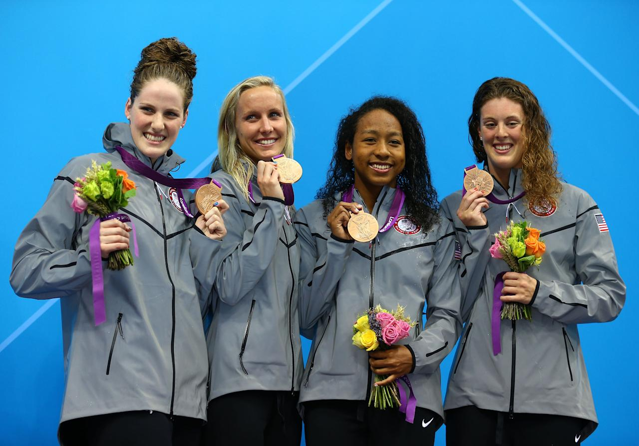 LONDON, ENGLAND - JULY 28:  (L-R) Missy Franklin, Jessica Hardy, Lia Neal and Allison Schmitt of the United States celebrate with their bronze medal during the the Medal Cermony for the Women's 4x100m Freestyle Relay on Day One of the London 2012 Olympic Games at the Aquatics Centre on July 28, 2012 in London, England.  (Photo by Al Bello/Getty Images)