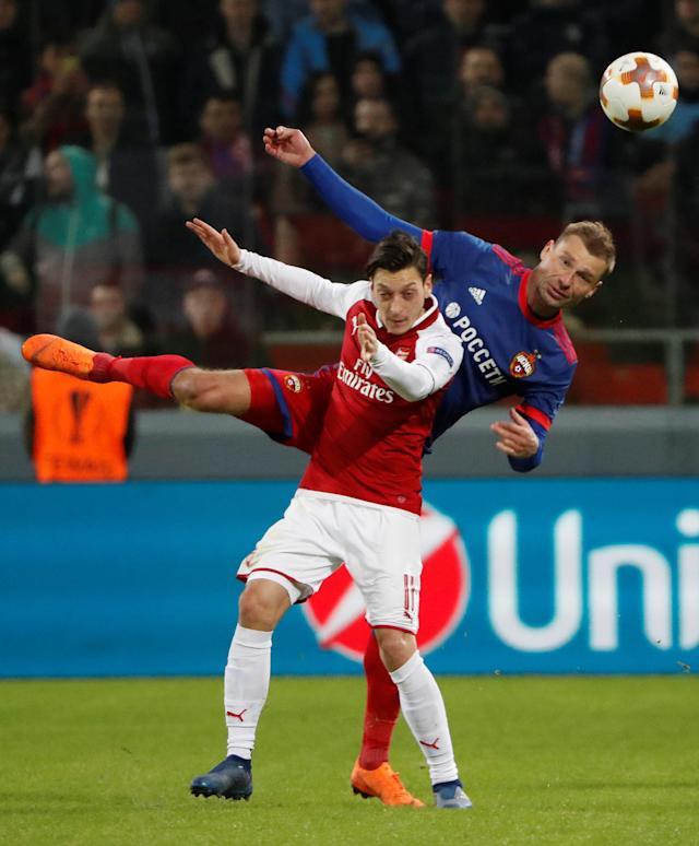 Soccer Football - Europa League Quarter Final Second Leg - CSKA Moscow v Arsenal - VEB Arena, Moscow, Russia - April 12, 2018 CSKA Moscow's Aleksei Berezutski in action with Arsenal's Mesut Ozil REUTERS/Grigory Dukor