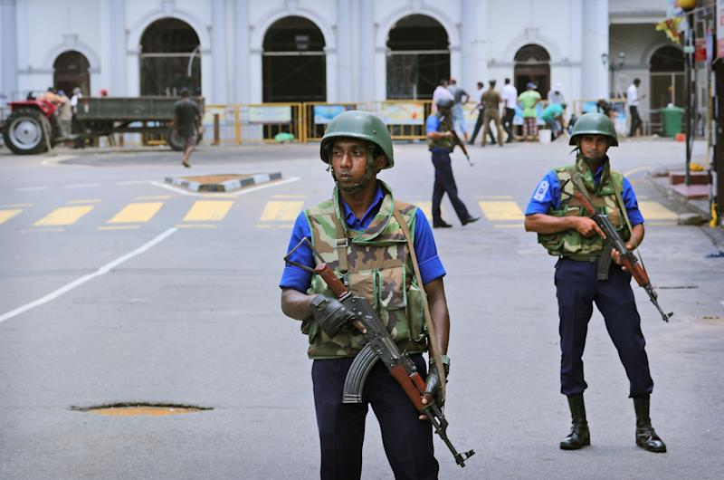 Sri Lankan soldiers guard a church in Colombo, the capital, on April 29, 2019.