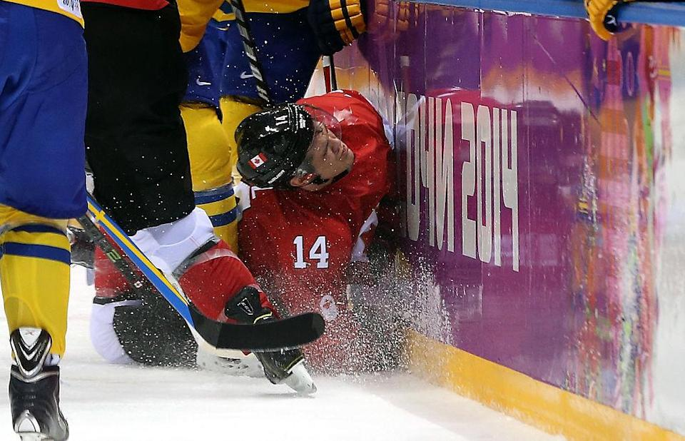 SOCHI, RUSSIA – FEBRUARY 23: Chris Kunitz #14 of Canada crashes into the boards during the Men's Ice Hockey Gold Medal match against Sweden on Day 16 of the 2014 Sochi Winter Olympics at Bolshoy Ice Dome on February 23, 2014 in Sochi, Russia. (Photo by Bruce Bennett/Getty Images)