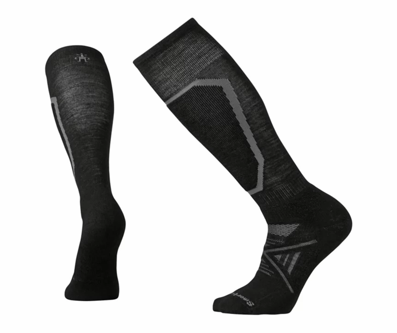 """<p><strong>Smartwool</strong></p><p>rei.com</p><p><strong>$26.95</strong></p><p><a href=""""https://go.redirectingat.com?id=74968X1596630&url=https%3A%2F%2Fwww.rei.com%2Fproduct%2F103582&sref=http%3A%2F%2Fwww.popularmechanics.com%2Fadventure%2Foutdoor-gear%2Fg29801041%2Frei-gear-up-get-out-sale%2F"""" target=""""_blank"""">Buy Now</a></p><p>Long days on the slopes are no match for the 14-inch PhD Ski Medium Socks. Minimal seams and just-right cushioning keep you comfortable, while the patent-pending Indestructawool construction (merino wool reinforced with nylon) delivers a sock that's built to last.</p>"""