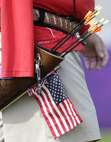 Eric Bennett of the United States walks into position with his quiver and arrows at the man's archery individual recurve standing bronze medal match at the 2012 Paralympics games, Monday, Sept. 3, 2012, in London. Bennett who shoots using his mouth to fire the arrows missed out on the bronze medal that was won by Mikhail Oyun of Russia. (AP Photo/Alastair Grant)