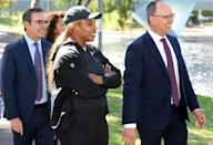 Serena Williams (C) completed two weeks' quarantine in Adelaide