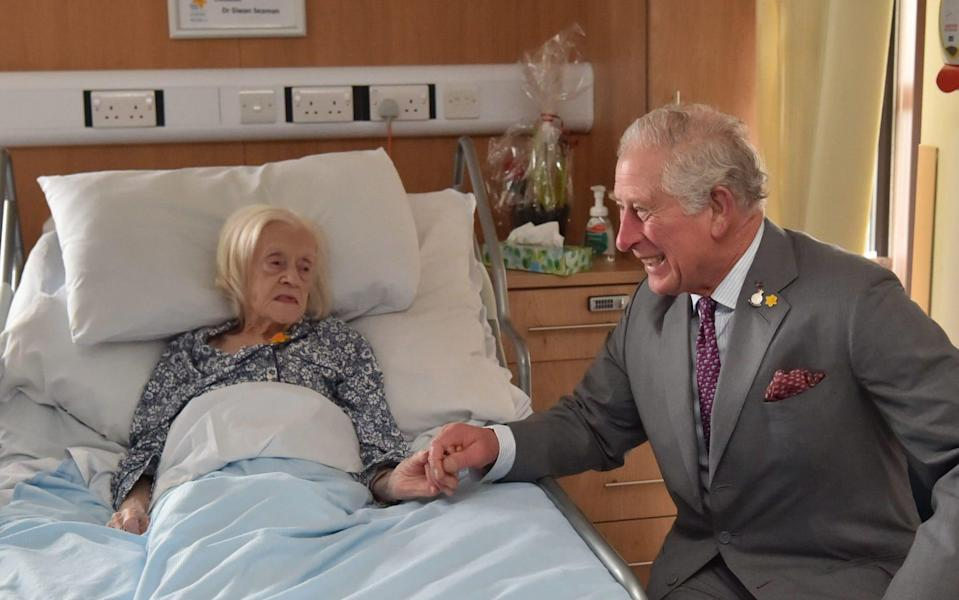 The Prince of Wales meeting patient Maureen Russell, 97, during a visit to the Marie Curie Hospice in Cardiff and the Vale, Wales. PA Photo. Picture date: Friday February 21, 2020. See PA story ROYAL Charles. Photo credit should read: Ben Birchall/PA Wire - Ben Birchall/PA Wire