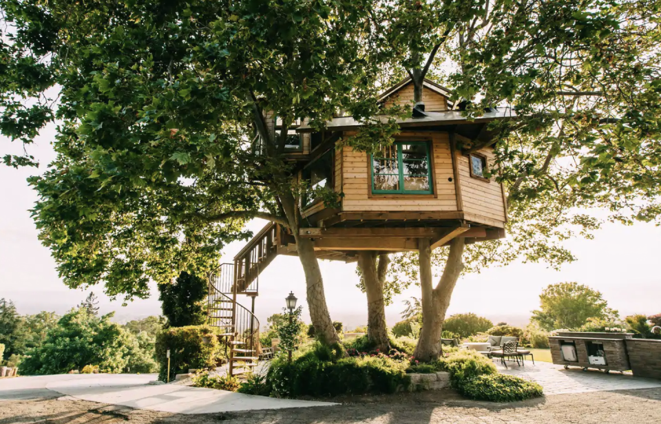 """<p>Perched on a hill in San Jose, this gorgeous treehouse overlooks Silicon Valley. A winding staircase leads to the 250-square-foot rustic house with all the amenities you could need. You'll want to spend your stay relaxing on the deck between three sycamore trees.</p><p><a class=""""link rapid-noclick-resp"""" href=""""https://www.airbnb.com/rooms/25671493?source_impression_id=p3_1595361192_37J0kMcN8J0WLHnu&guests=1&adults=1"""" rel=""""nofollow noopener"""" target=""""_blank"""" data-ylk=""""slk:BOOK NOW"""">BOOK NOW</a> <strong><em>San Jose Treehouse</em></strong></p>"""