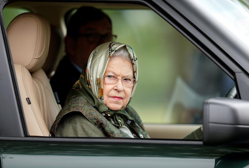 Queen Elizabeth II driving her Range Rover as she attends day 4 of the Royal Windsor Horse Show in Home Park on May 13, 2017, in Windsor, England.
