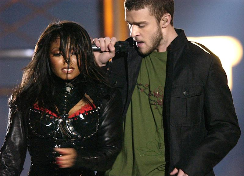 """FILE - In this Feb. 1, 2004 file photo, singers Justin Timberlake and Janet Jackson are seen during their performance prior to a wardrobe malfunction during the half time performance at Super Bowl XXXVIII in Houston. The Supreme Court decided Friday not to consider reinstating the government's $550,000 fine on CBS for Janet Jackson's infamous breast-bearing """"wardrobe malfunction"""" at the 2004 Super Bowl. (AP Photo/David Phillip, file)"""