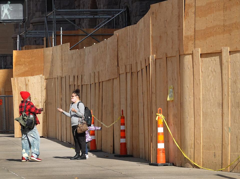 Plywood covers a building front near the Hennepin County Government Center in preparation for the trial of former Minneapolis police officer Derek Chauvin on 28 March, 2021Getty Images