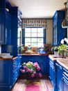 "<p>Vibrant cobalt cabinetry turns this petit butler's pantry into the colorful pièce de résistance within this <a href=""https://www.ruthiesommers.com/"" rel=""nofollow noopener"" target=""_blank"" data-ylk=""slk:Ruthie Sommers-designed"" class=""link rapid-noclick-resp"">Ruthie Sommers-designed</a> Rhode Island retreat. The <a href=""https://lawrenceoflabrea.com/"" rel=""nofollow noopener"" target=""_blank"" data-ylk=""slk:Lawrence of La Brea"" class=""link rapid-noclick-resp"">Lawrence of La Brea </a>rug brings out the subtle red tones of the valance in an eccentric <a href=""https://www.katieridder.com/"" rel=""nofollow noopener"" target=""_blank"" data-ylk=""slk:Katie Ridder"" class=""link rapid-noclick-resp"">Katie Ridder</a> fabric. The custom cobalt paint color is from Fine Paints of Europe.</p><p><a class=""link rapid-noclick-resp"" href=""https://www.finepaintsofeurope.com/Paints.aspx"" rel=""nofollow noopener"" target=""_blank"" data-ylk=""slk:Get the Look"">Get the Look</a><br></p>"