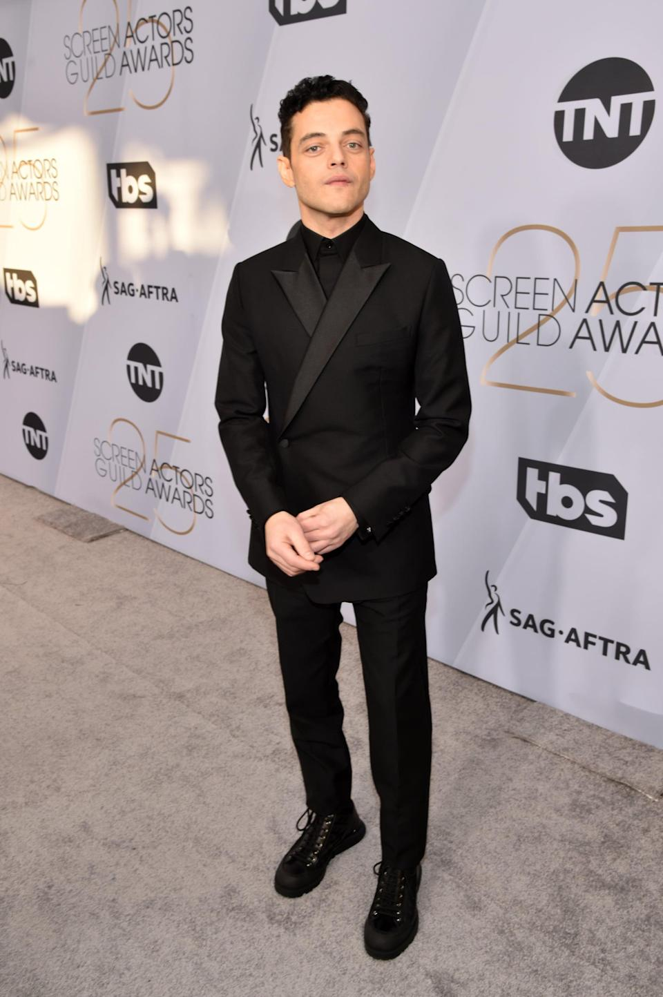 <p>Wearing a Dior Men suit with Cartier accessories. </p>