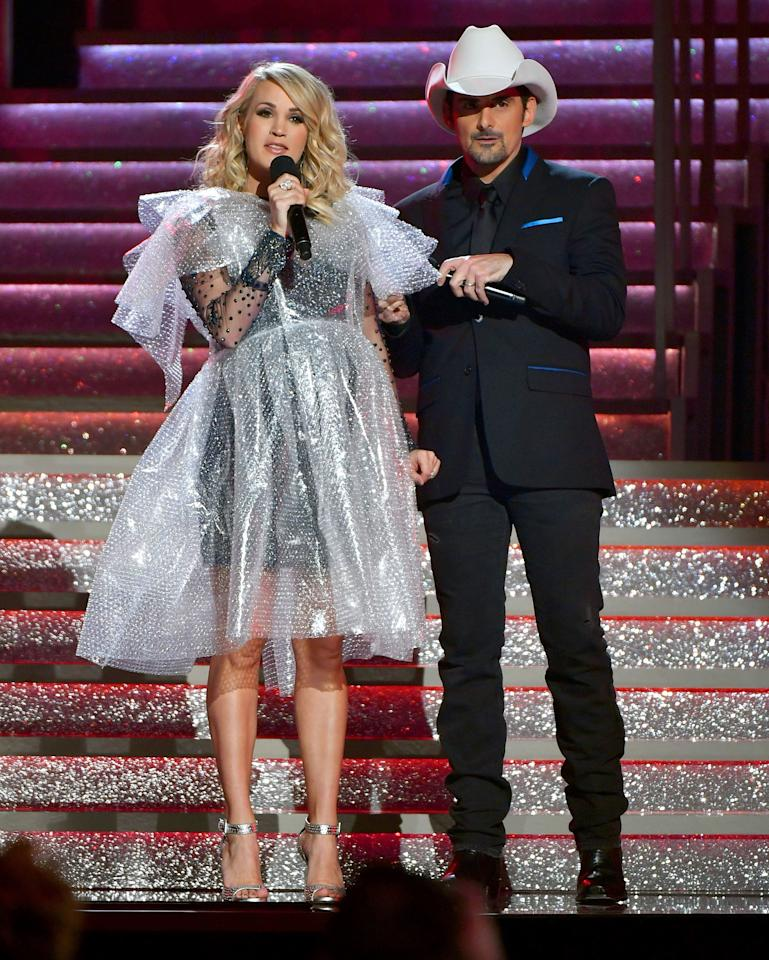"After talking to PEOPLE about their great chemistry, the pair hit the stage at the 52nd annual CMA Awards in Nashville to deliver one of their signature spoof songs — and reveal the sex of <a href=""https://people.com/parents/carrie-underwood-mike-fisher-announce-sex-second-child-boy/"">Underwood's baby on the way</a> (a boy!). Later on, in a nod to Underwood's 2017 fall that injured her face, Paisley presented her with a bubble wrap dress that she said she wouldn't wear ... <a href=""https://people.com/country/cma-awards-2018-carrie-underwood-bubble-wrap-dress/"">but later did</a> (and so well!)."