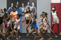 Girls participate in dance moves, Thursday, July 22, 2021, at Power Moves Gymnastics and Fitness in Cedarhurst, N.Y. The face of gymnastics in the United States is changing. There are more athletes of color starting — and sticking — in a sport long dominated by white athletes at the highest levels. (AP Photo/Mark Lennihan)