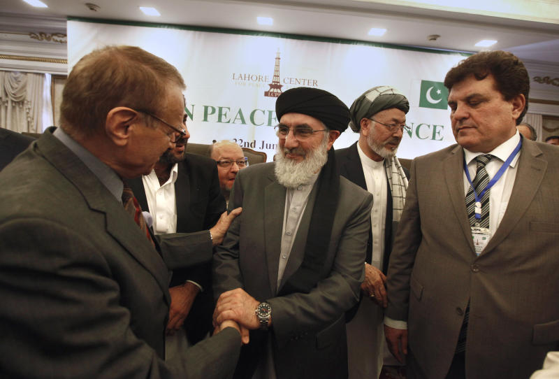 Afghan Warlord Gulbuddin Hekmatyar, leader of Islamist organization Hezb-i-Islami, center, shakes hand with a paticipant after the opening session of Afghan Peace Conference in Bhurban, 65 kilometers (40 miles) north of Islamabad, Pakistan, Saturday, June 22, 2019. Dozens of Afghan political leaders attended a peace conference in neighboring Pakistan on Saturday to pave the way for further Afghan-to-Afghan dialogue. (AP Photo/Anjum Naveed)
