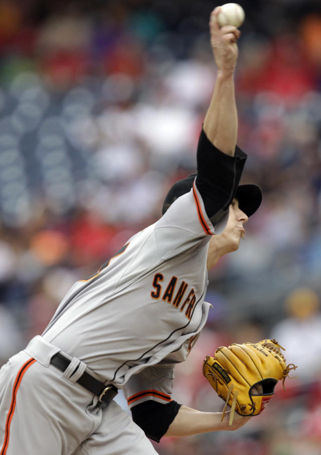 San Francisco Giants pitcher Tim Lincecum throws the ball during the first inning of a baseball game against the Washington Nationals, Saturday, Aug. 23, 2014, in Washington. (AP Photo/Luis M. Alvarez)