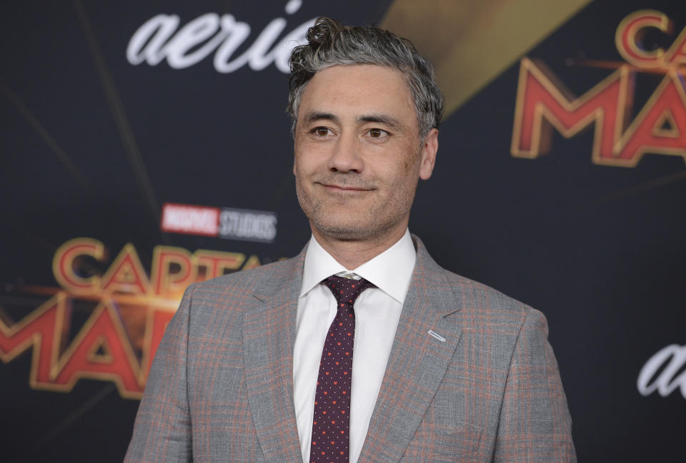 """Taika Waititi arrives at the world premiere of """"Captain Marvel"""" on Monday, March 4, 2019, at the El Capitan Theatre in Los Angeles. (Photo by Jordan Strauss/Invision/AP)"""