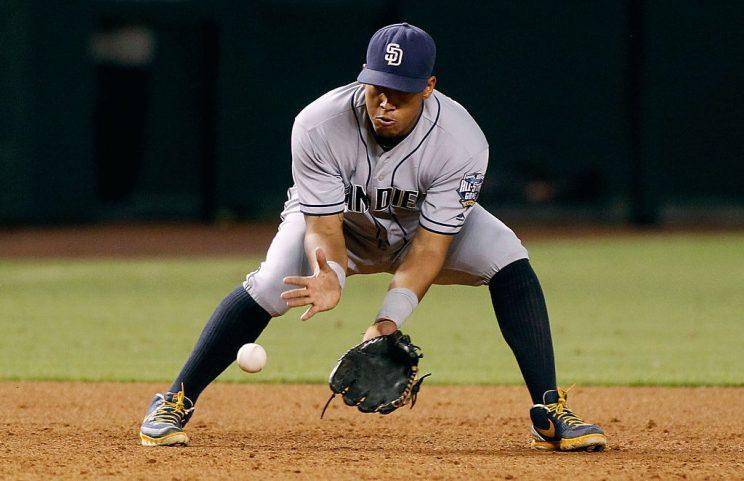 PHOENIX, AZ - OCTOBER 01: Third baseman Yangervis Solarte #26 of the San Diego Padres fields a ground ball against the Arizona Diamondbacks during the sixth inning of a MLB game at Chase Field on October 1, 2016 in Phoenix, Arizona. (Photo by Ralph Freso/Getty Images)