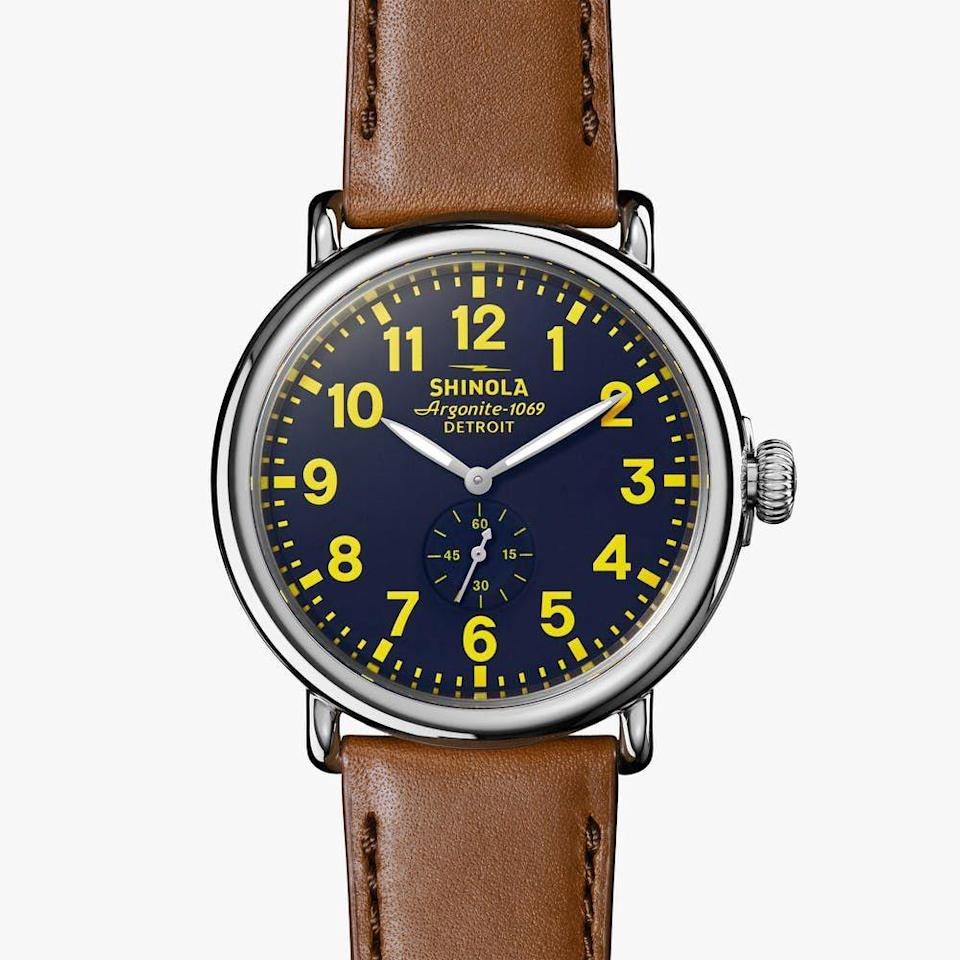 "<p><a class=""link rapid-noclick-resp"" href=""https://www.shinola.com/mens/watches/the-runwell/therunwell47-leather-watch-s02278.html"" rel=""nofollow noopener"" target=""_blank"" data-ylk=""slk:BUY IT HERE"">BUY IT HERE</a></p><p>Built by hand in Detroit, Shinola is an All-American brand through and through. They take classic watch silhouettes and inject a modern dose of masculinity into them via unexpected color combinations and rustic features. Take this Runwell style that features a handsome brown leather strap, a sleek navy blue face with chrome detailing, and bright yellow numerals. A feast for the eyes that's not too hard on the wallet either. </p>"