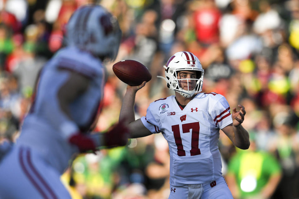 Wisconsin quarterback Jack Coan passes against Oregon during first half of the Rose Bowl NCAA college football game Wednesday, Jan. 1, 2020, in Pasadena, Calif. (AP Photo/Mark J. Terrill)