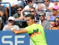 Aug 30, 2014; New York, NY, USA; Milos Raonic (CAN) returns a shot to Victor Estrella Burgos (DOM) on the Grandstand Court on day six of the 2014 U.S. Open tennis tournament at USTA Billie Jean King National Tennis Center. (Anthony Gruppuso-USA TODAY Sports)