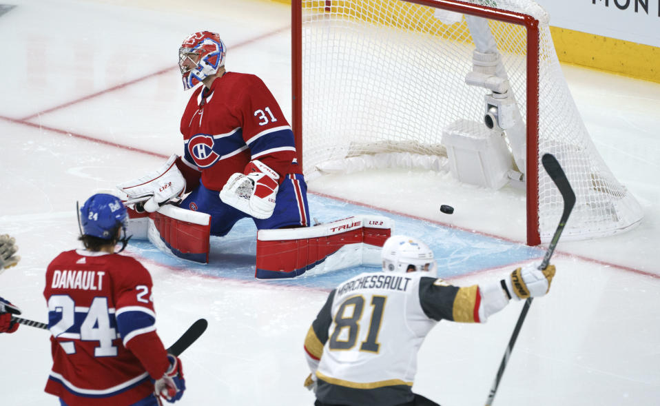 Vegas Golden Knights' Jonathan Marchessault celebrates a goal by Alex Pietrangelo on Montreal Canadiens goaltender Carey Price during the third period of Game 3 of an NHL hockey semifinal series, Friday, June 18, 2021, in Montreal. (Paul Chiasson/The Canadian Press via AP)