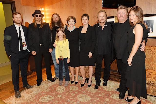 NASHVILLE, TN - MAY 02: (EXCLUSIVE COVERAGE) (L-R) Dierks Bentley, Kid Rock, Jamey Johnson, Kaylee Johnson, Laura Bush, Nancy Jones, Travis Tritt, Joe Diffie, and Theresa Crump attend the funeral service for George Jones at The Grand Ole Opry on May 2, 2013 in Nashville, Tennessee. Jones passed away on April 26, 2013 at the age of 81. (Photo by Rick Diamond/Getty Images for GJ Memorial)