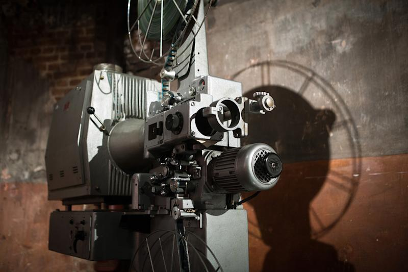 "A film projector in the ""Cinema des Cineastes"" movie theater, in Paris. (Credit: LOIC VENANCE/AFP/Getty Images)"
