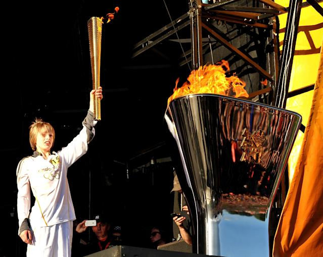 LEEDS, ENGLAND - JUNE 24: Aaron Bell Olympic Torch Bearer selected through Coca-Cola's Future Flames carries the torch at Leeds Temple Newsam Park, presented by Coca-Cola on June 24, 2012 in Leeds, United Kingdom. (Photo by Shirlaine Forrest/Getty Images for Coca-Cola)