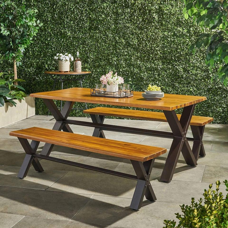 <p>Friends and family will love the look of this <span>Sanibel Acacia Wood Dining Set</span> ($800).</p>